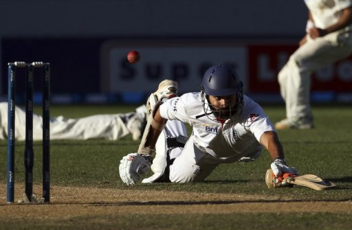 England's Monty Panesar dives to make a run against New Zealand on March 26, 2013
