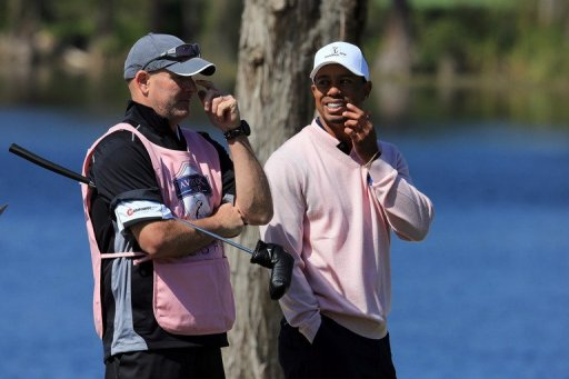 Tiger Woods with caddie Joe LaCava during the final day of the 2013 Tavistock Cup Matches on March 26, 2013 in Orlando