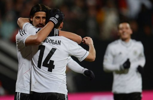 Germany's Holger Badstuber and Sami Khedira (L) celebrate scoring in Nuremberg, on March 26, 2013