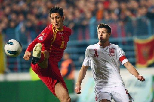 Montenegro forward Stevan Jovetic (L) shields the ball from Steven Gerrard on March 26, 2013
