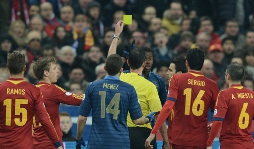 France midfielder Paul Pogba receives a yellow card during the World Cup qualifier against Spain on March 26, 2013