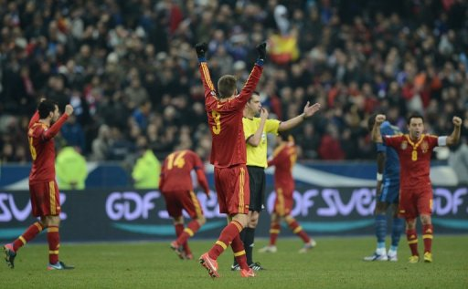 Spanish players celebrate at the end of the World Cup qualifier against France on March 26, 2013