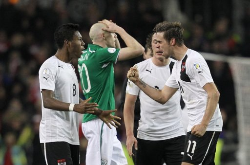 Austria's Martin Harnik (R) and David Alaba celebrate at the final whistle on March 26, 2013