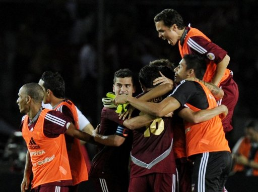 Venezuela's players celebrate defeating Colombia in a World Cup qualifier on March 26, 2013