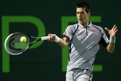 Novak Djokovic returns a shot to Tommy Haas at the Miami Masters on March 26, 2013