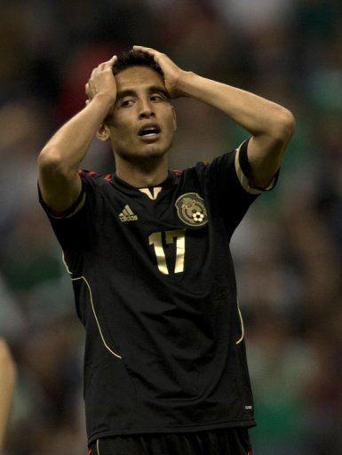 Mexico's Jesus Zavala reacts after missing an opportunity against the USA on March 26, 2013