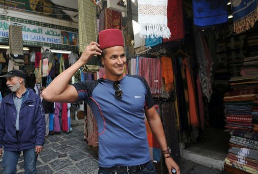 Olympic champion Oussama Mellouli visits the souk in Tunis on March 22, 2013