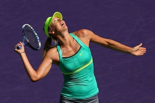 Maria Sharapova hits a smash against Sara Errani at the Miami Masters on March 27, 2013