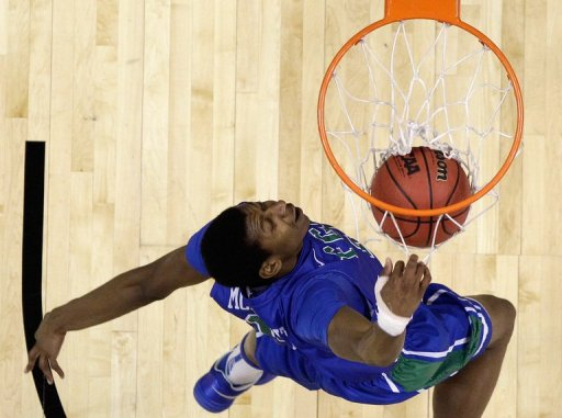 Eric McKnight of the Florida Gulf Coast Eagles dunks the ball on March 24, 2013