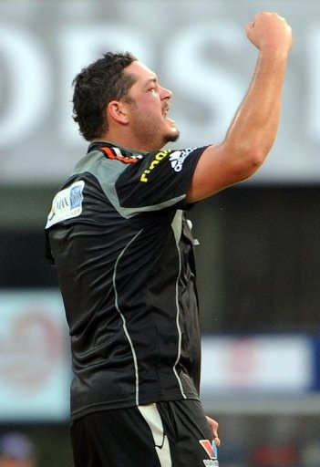 Jesse Ryder celebrates taking a wicket for Pune Warriors against Delhi Daredevils on April 17, 2011