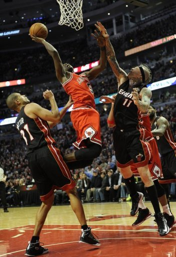 Luol Deng of the Chicago Bulls jumps for the basket on March 27, 2013