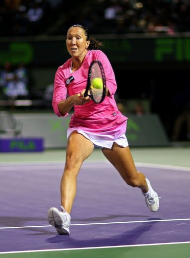 Jelena Jankovic of Serbia plays a backhand to Roberta Vinci at the Miami Masters on March 27, 2013