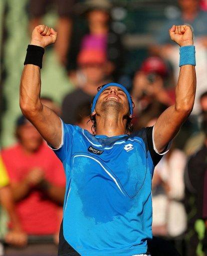 David Ferrer celebrates beating Jurgen Melzer at the Miami Masters on March 27, 2013