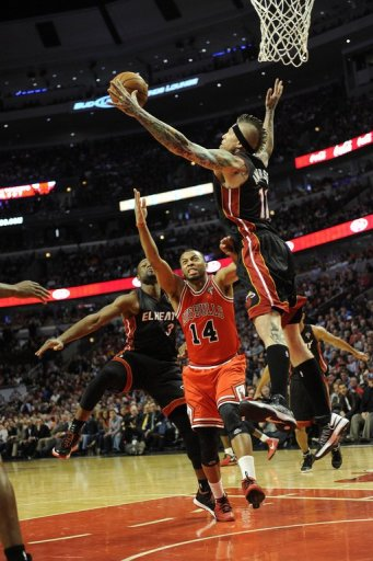 Chris Andersen (R) of the Miami Heat blocks a shot by Daequan Cook of the Chicago Bulls on March 27, 2013
