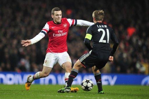 Arsenal's Jack Wilshere (L) nutmegs Bayern Munich's Philipp Lahm at the Emirates Stadium on February 19, 2013