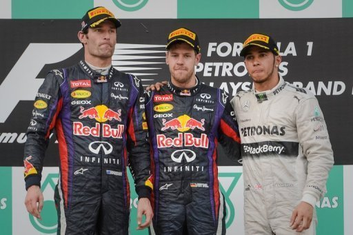 Mark Webber (L), team-mate Sebastian Vettel (C) and Lewis Hamilton on the podium in Sepang on March 24, 2013