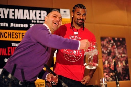 David Haye (R) and his trainer Adam Booth joke with journalists at a central London press conference on March 28, 2013