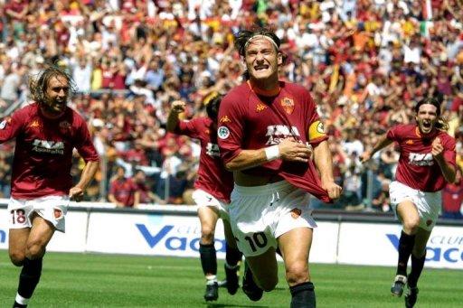 Francesco Totti celebrates after scoring at Rome's Olympic Stadium, on June 17, 2001
