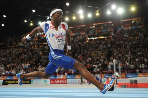 France's Teddy Tamgho competing in the men's triple jump at the Bercy Palais-Omnisport in Paris March 6, 2011