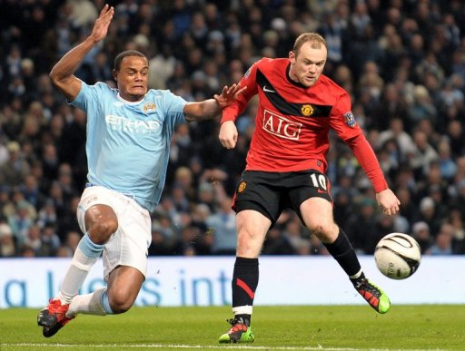 Manchester United's Wayne Rooney (right) and Manchester City's Vincent Kompany on January 19, 2010