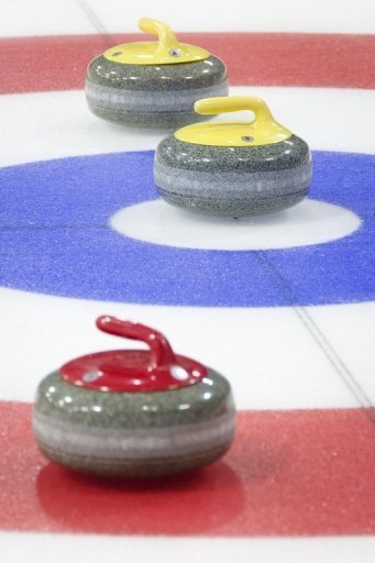 Curling stones are shown in play during a test event at the Olympic Curling Centre in Adler, Russia on February 21, 2013