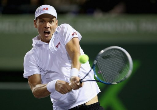 Tomas Berdych of Czech Republic plays a backhand on March 28, 2013 in Key Biscayne, Florida