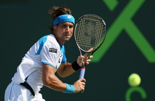 David Ferrer of Spain runs to line up a backhand against Tommy Haas of Germany, March 29, 2013 in Key Biscayne, Florida