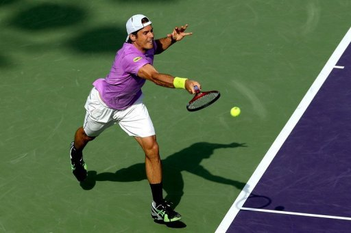 Tommy Haas of Germany returns a shot to David Ferrer of Spainon March 29, 2013 in Key Biscayne, Florida