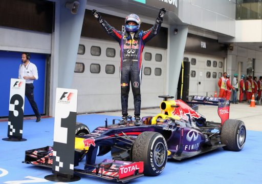 Red Bull driver Sebastian Vettel celebrates victory in the Malaysia Grand Prix in Sepang on March 24, 2013