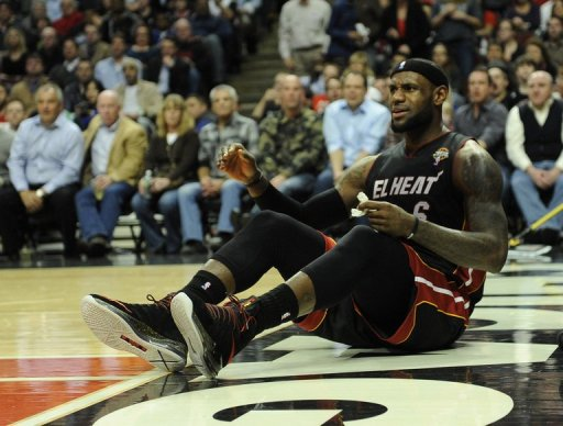 LeBron James of the Miami Heat sits on the court after being fouled on March 27, 2013