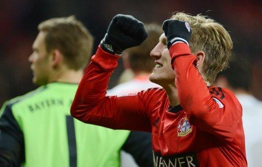 Bayern Munich midfielder Bastian Schweinsteiger celebrates victory over Bayer Leverkusen on March 16, 2013