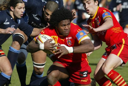 Samueli Naulu (C), during the French Top 14 rugby match on February 18, 2006, at the Aime Giral Stadium in Perpignan