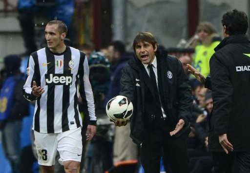 Juventus' coach Antonio Conte gestures with a ball on March 30, 2013, at the San Siro stadium in Milan