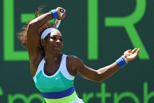 Serena Williams returns a shot to Maria Sharapova in the Miami Masters on March 30, 2013