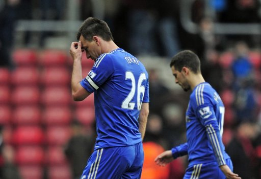 Chelsea defender John Terry (L) and midfielder Eden Hazard trudge off after the defeat at Southampton on March 30, 2013