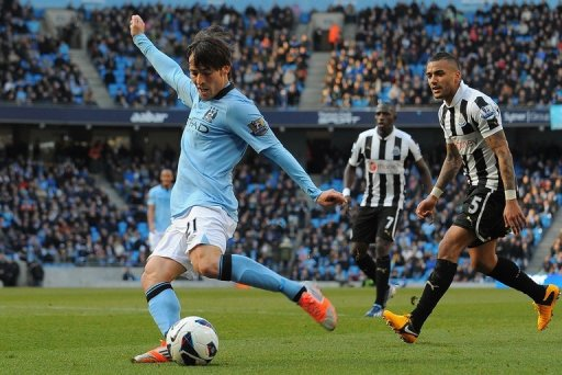 Manchester City midfielder David Silva scores the second goal in the win over Newcastle United on March 30, 2013