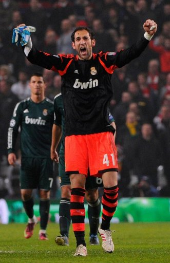 Real Madrid goalkeeper Diego Lopez celebrates victory over Manchester United on March 5, 2013
