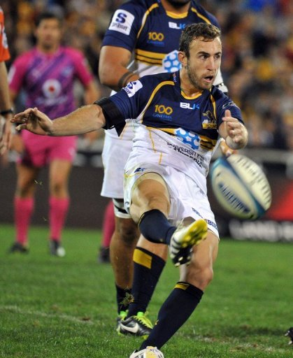 Nic White of the Brumbies kicks the ball during a match against the Northern Bulls, in Canberra, on March 30, 2013