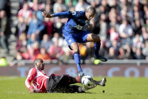 Sunderland's Titus Bramble (left) vies with Manchester United's Ashley Young in Sunderland on March 30, 2013