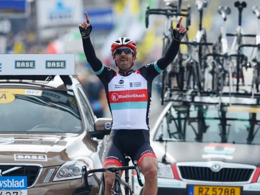 Swiss cyclist Fabian Cancellara celebrates as he crosses the finish line of the Tour of Flanders on March 31, 2013
