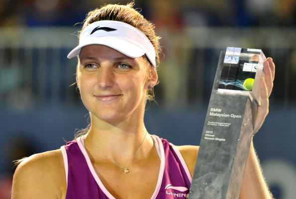 Karolina Pliskova of Czechoslovakia poses with her trophy after beating Bethanie Mattek-Sands of the United States during their women's final singles match at the BMW Malaysian Open tennis tournament in Kuala Lumpur on March 3, 2013.  Pliskova won 1-6, 7-5, 6-3.