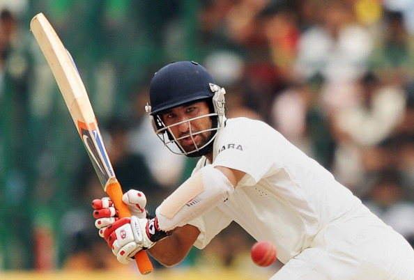 India's Cheteshwar Pujara plays a shot d