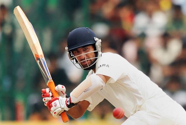 India's Cheteshwar Pujara plays a shot d