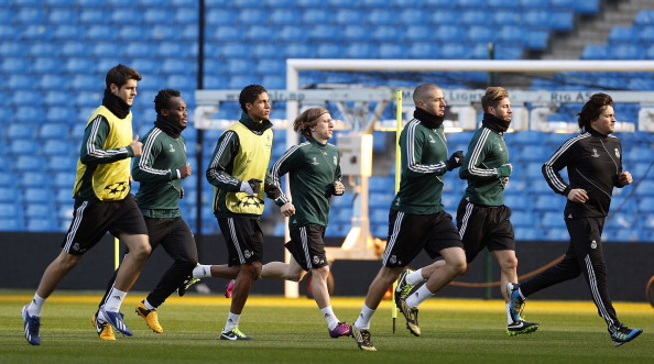 Real Madrid players run during a training session ahead of their UEFA Champions League Round of 16 match against Manchester United at Etihad Stadium on March 4, 2013 in Manchester, England.