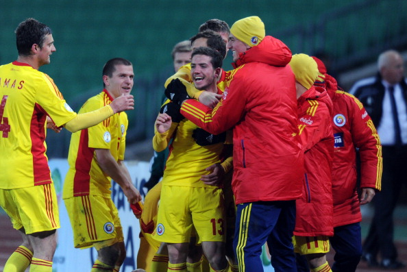 Romanian midfielder Alexandru Chipciu celebrates a score with his teammates during Hungary vs Romania FIFA 2014 World Cup qualifying football match in Budapest, on March 22, 2013.