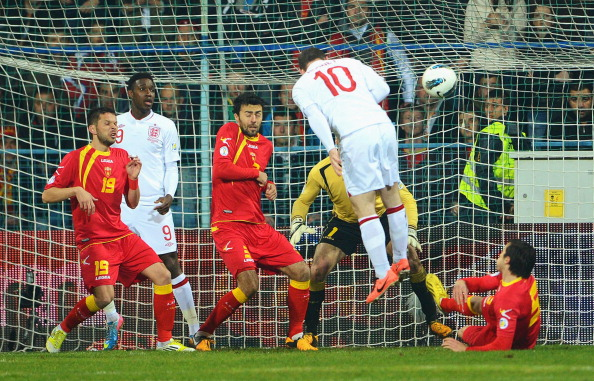 PODGORICA, MONTENEGRO - MARCH 26:  Wayne Rooney of England scores the opening goal with a header during the FIFA 2014 World Cup Qualifier Group H match between Montenegro and England at City Stadium