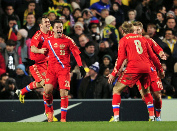 Russia's midfielder Viktor Fayzulin (2L) celebrates scoring the opening goal during the international friendly football match between Brazil and Russia at Stamford Bridge stadium in London on March 25, 2013 .