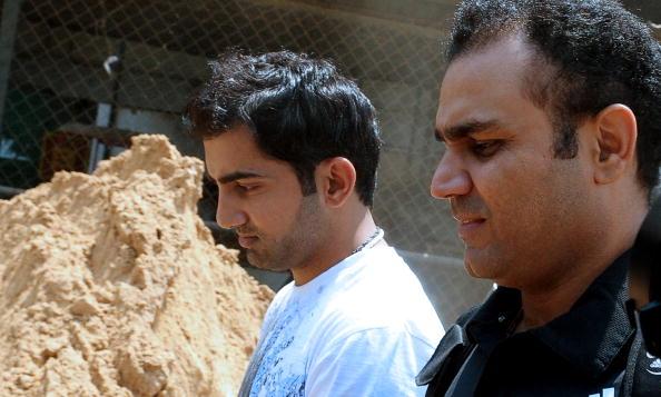 Indian cricketers Gautam Gambhir (C) and