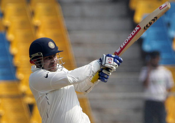 Virender Sehwag hits one his trademark shots to the boundary