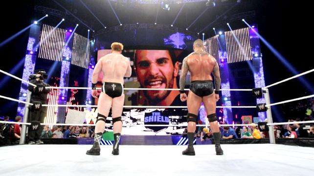 Seth Rollins of the Sheild appears on the titantron to challenge  Randy Orton and Sheamus to a match at Wrestlemania 29